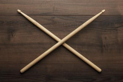 Crossed Wooden Drumsticks On Wooden Table