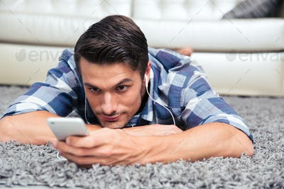 Man using smartphone on the floor