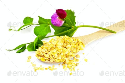 Pea flakes in a spoon with a flower