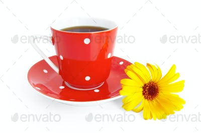 Red coffee cup with a yellow flower