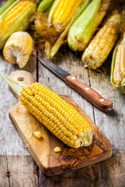 organic sweet corn on cutting board