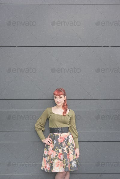 young handsome redhead caucasian woman posing