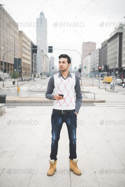 Young indian businessman using smartphone