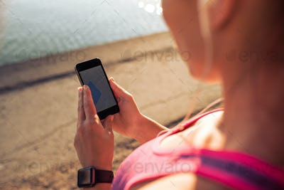Sports woman using smart phone