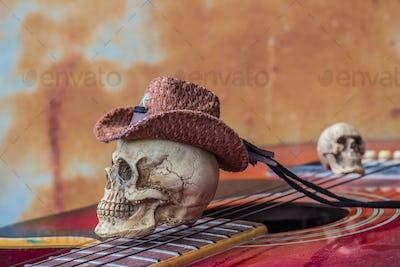 The skull cap at the top guitarist