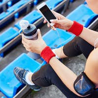 Active girl with smartphone