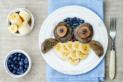 blueberry chocolate pancake with bananas in the shape of an owl