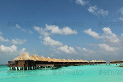 Water villas on tropical caribbean island in Maldives
