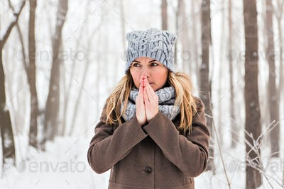 Portrait of a woman feeling cold in winter - outdoors