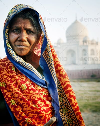 Indigenous Indian Woman And Taj Mahal Backgroud Concept