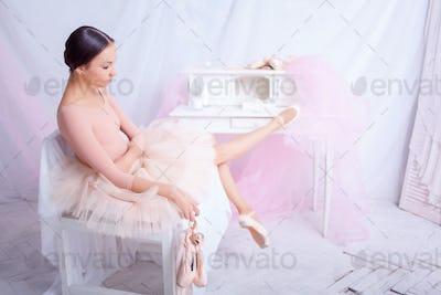 Professional ballet dancer resting after the performance.