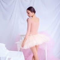 Professional ballet dancer posing on pink