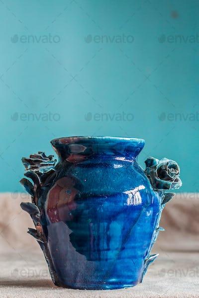 blue vase on desk