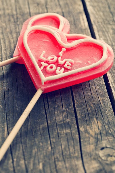 Lollipop heart on vintage wooden background