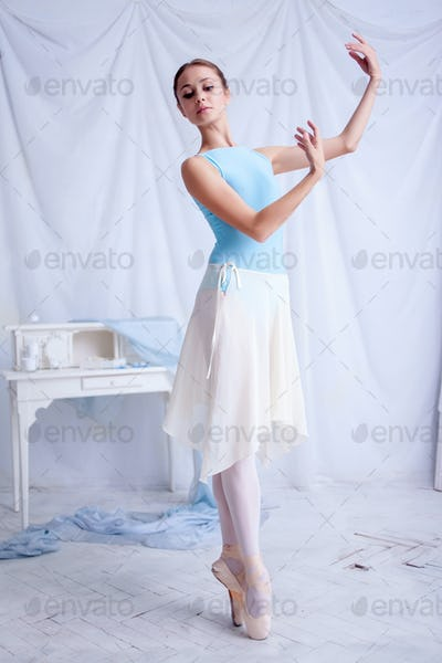 Professional ballet dancer posing on white