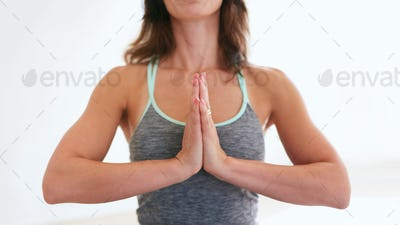 Fitness woman practicing yoga in gym