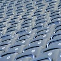 Grey seats in a football stadium