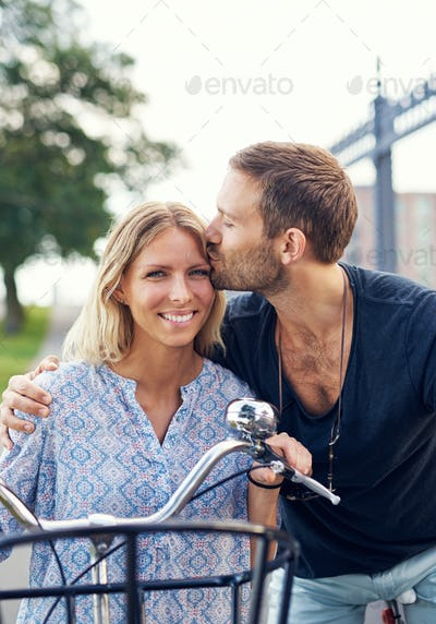 Affectionate young man kissing his girlfriend