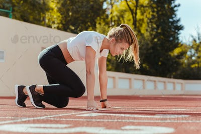 Woman in start position for run
