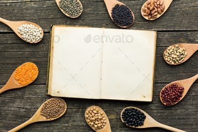 blank cookbook and various legumes
