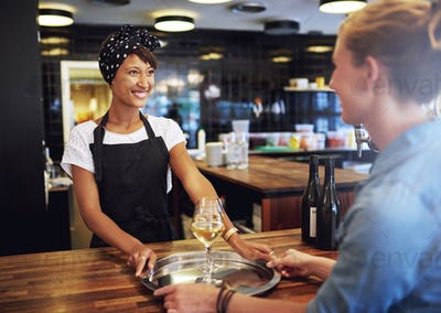 Waitress Serving Glasses of Wine to Customer