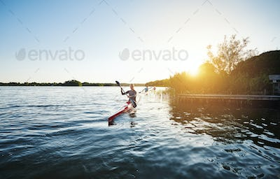Woman kayaking in the sunset