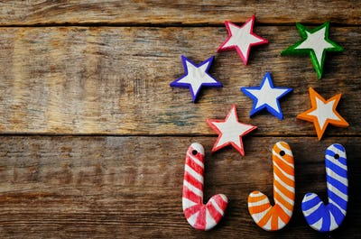 wooden background with wooden toys in the shapes of stars and Ch