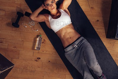 Determined woman ready to do sit-ups