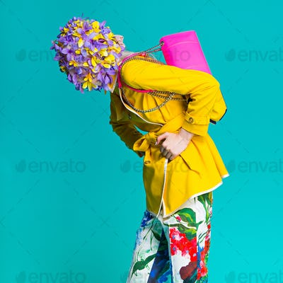 Fashion model in yellow coat