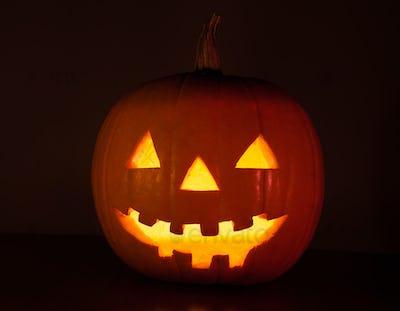 Halloween pumpkin glowing in the dark