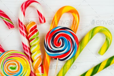 Colorful candy on white wooden background