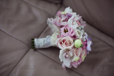 Beautiful bridal bouquet on leather background