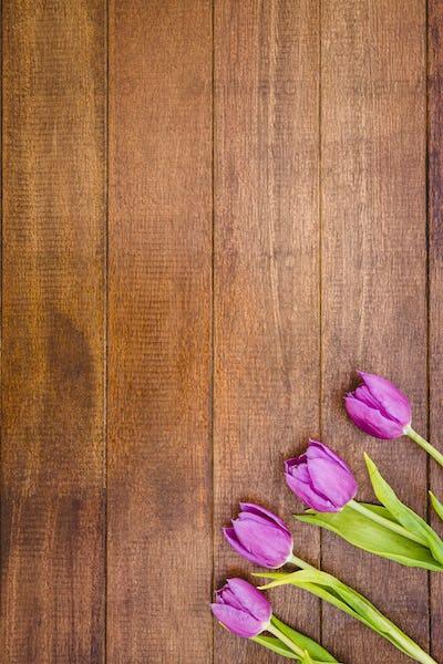 Bouquet of purple beautiful flowers on wood desk