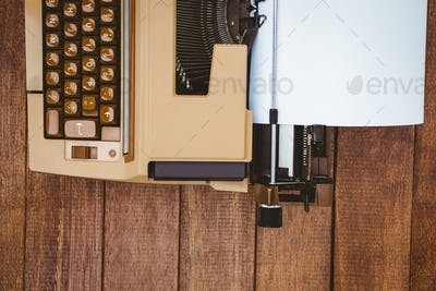 View of an old typewriter on wood desk