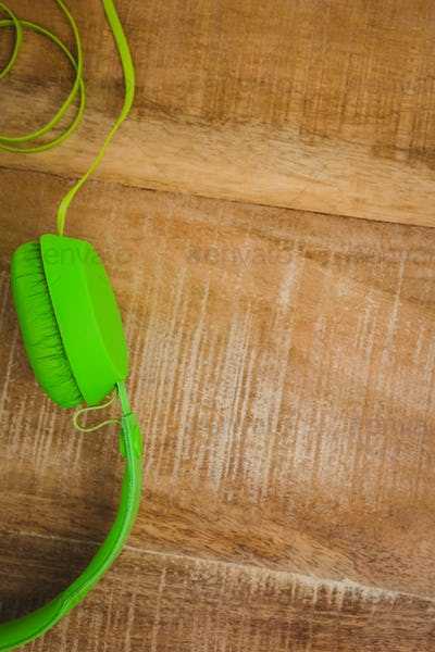 Close up view of a green headphone