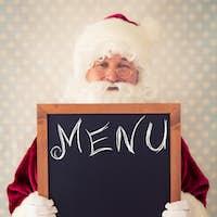 Santa Claus holding blackboard