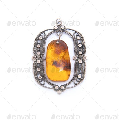 Yellow amber in a silver frame.