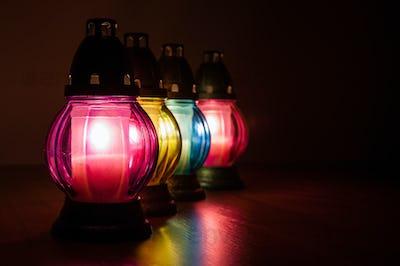 Burning votive candles in the dark