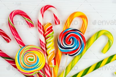Colorful candy on the wooden background