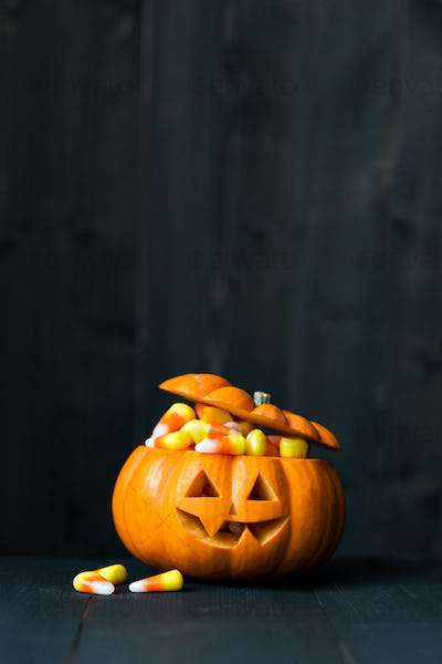 Jack o lantern filled with candy corn