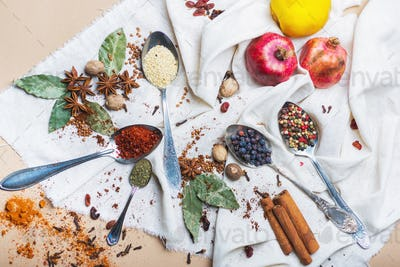 mix of different spices and herbs, cook and cuisine ingredients on the table.