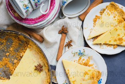 Top view of delicious homemade cake filled with lemon and sweet milk with decor