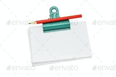 Bulldog clip holding loose memo papers