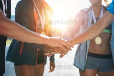Team with hands together celebrating success