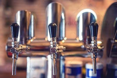 Beer tap at restaurant, bar or pub. Close-up details of beer dra