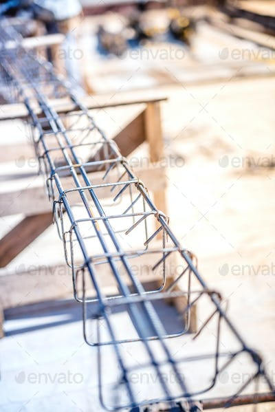 Reinforced steel bars on new building construction foundation site