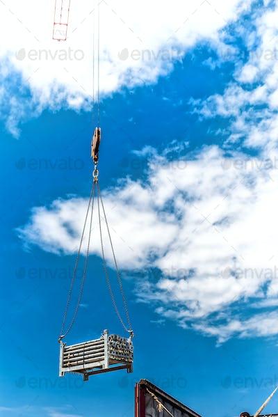 industrial crane lifting metalic structures of building of skyscraper