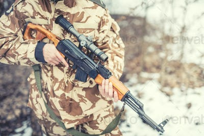 details of equipment and gun on military ranger - War, hunting or protection concept with man