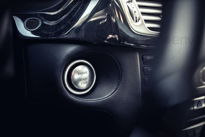 close-up of modern car start and stop ignition button.