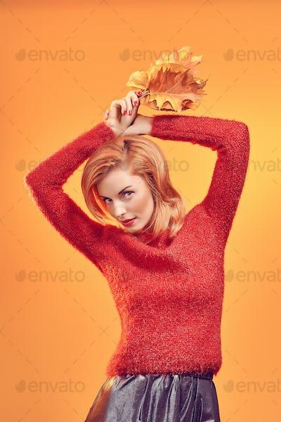 Beauty portrait redhead woman autumn leafs,vintage